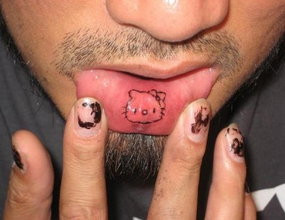 Something is. Hello kitty lip tattoo words