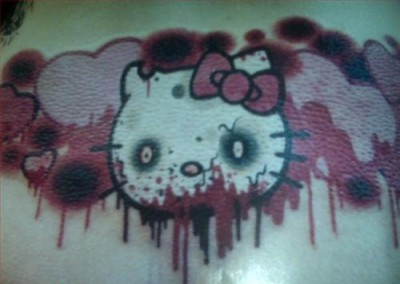hello kitty heart eating zombie tattoo