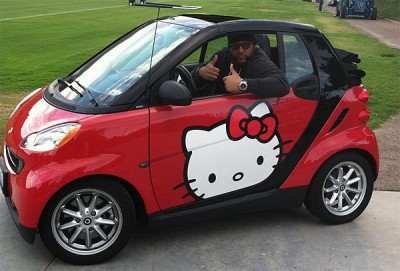 Antonio Garay, a football player, drives a Hello Kitty smart car