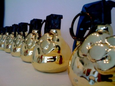 a line of gold Hello Kitty hand grenades