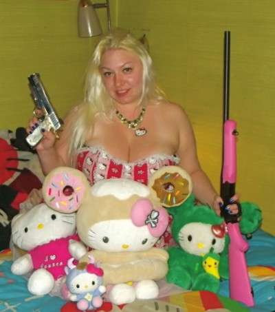 hello Kitty fanatic with rifle and hand gun